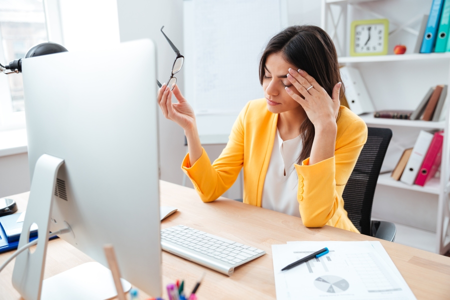 businesswoman-having-head-pain-PYQ8FP6.jpg